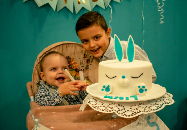 Portrait Of Smiling Siblings Enjoying During Birthday Party