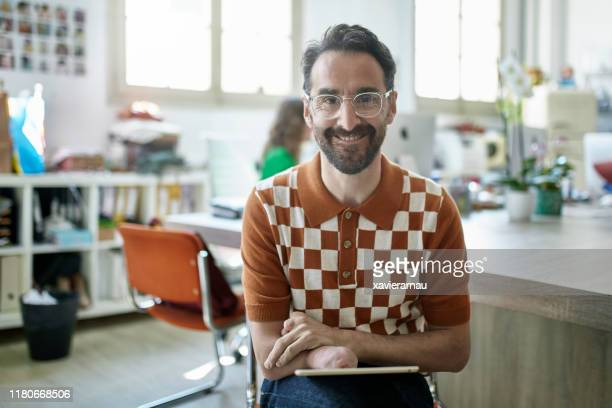 portrait of smiling spanish design professional in studio - persons with disabilities stock pictures, royalty-free photos & images