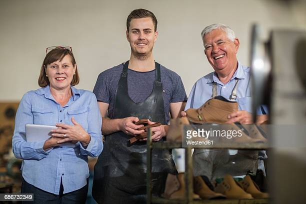 Portrait of smiling staff in shoemakers workshop