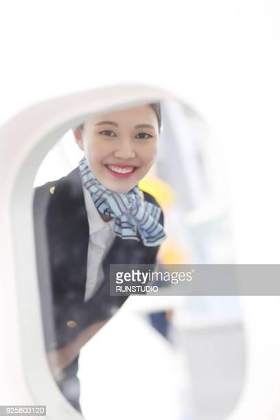 Portrait of smiling stewardess in airplane