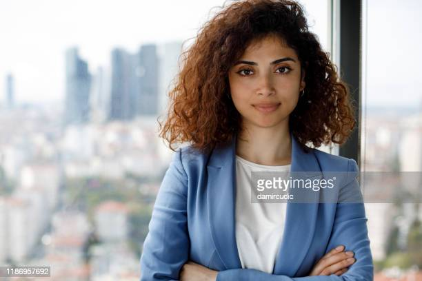 portrait of smiling successful young businesswoman - damircudic stock photos and pictures