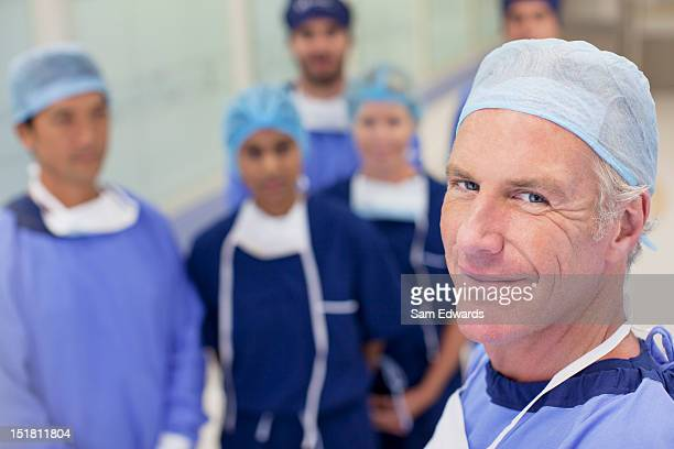 portrait of smiling surgeons and nurses in hospital - medium group of people stock pictures, royalty-free photos & images