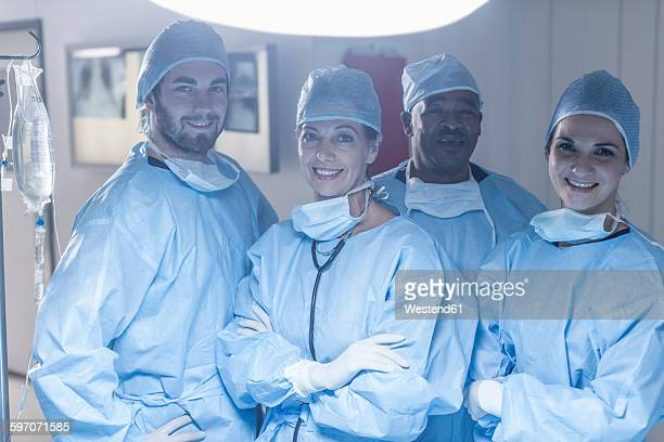 Portrait of smiling surgical team