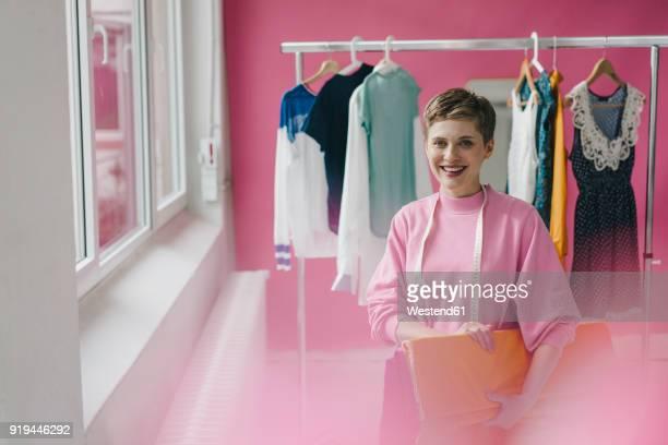 portrait of smiling tailoress - designberuf stock-fotos und bilder