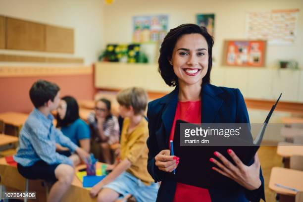 Portrait of smiling teacher in class