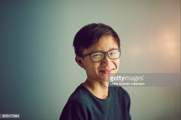 portrait of smiling teenage boy - teenagers only stock pictures, royalty-free photos & images
