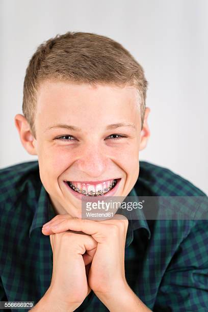 Portrait of smiling teenage boy with braces