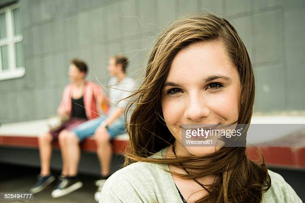 Portrait of smiling teenage girl outdoors