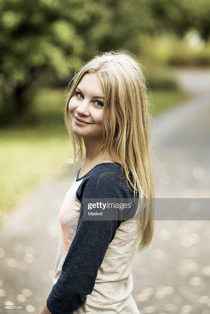 Portrait Of Smiling Teenage Girl Standing On Street Stock Photo  Getty Images-5893