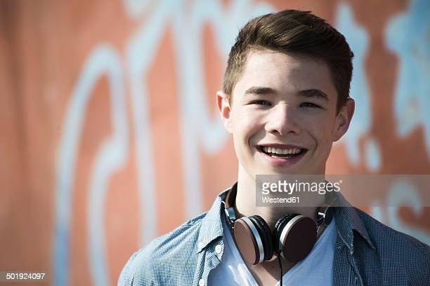Portrait of smiling teenager with headphones