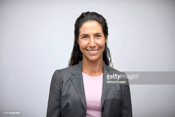 portrait of smiling well-dressed businesswoman - blazer jacket stock pictures, royalty-free photos & images