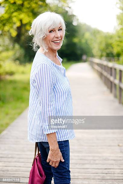portrait of smiling white haired senior woman - rolled up sleeves stock photos and pictures