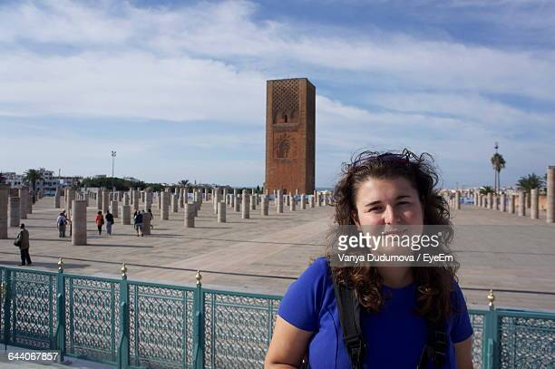Portrait Of Smiling Woman Against Hassan Tower