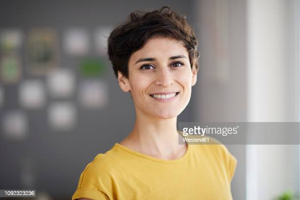 portrait of smiling woman at home - top garment stock pictures, royalty-free photos & images