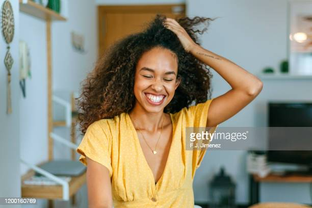 portrait of smiling woman at home - mouth open stock pictures, royalty-free photos & images