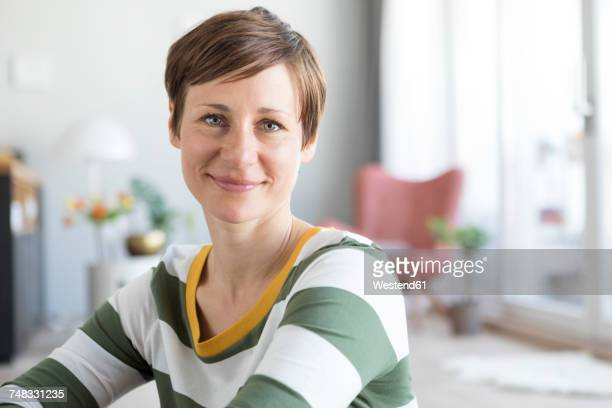 portrait of smiling woman at home - 35 39 years stock pictures, royalty-free photos & images