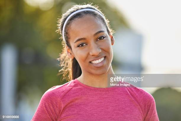 portrait of smiling woman at park - all shirts stock pictures, royalty-free photos & images