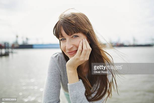 Portrait of smiling woman at the waterfront