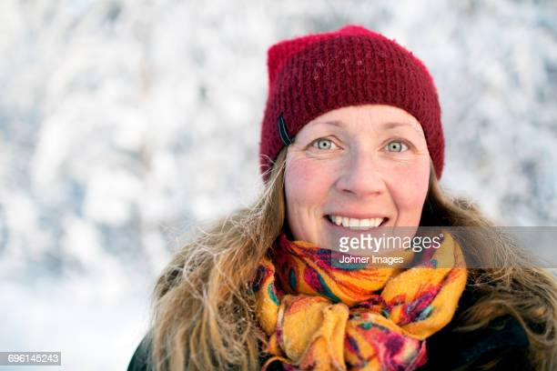 Portrait of smiling woman at winter