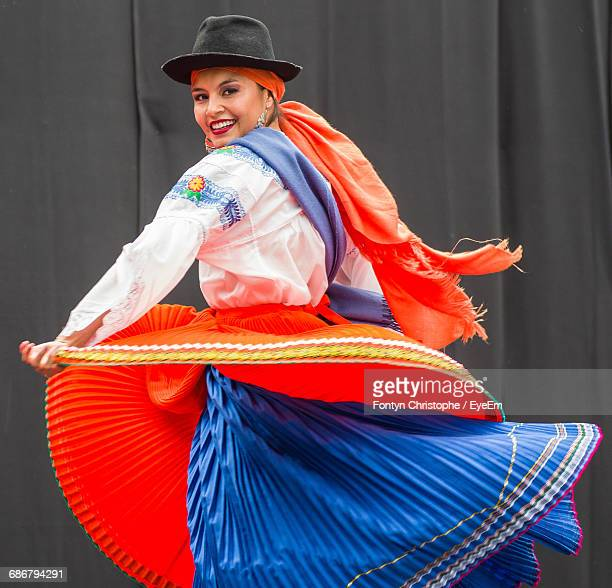 portrait of smiling woman dancing on stage during traditional festival - ecuador fotografías e imágenes de stock