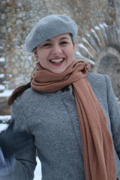 Portrait Of Smiling Woman During Winter