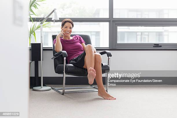 Portrait of smiling woman in armchair