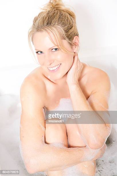 Portrait of smiling woman in bath