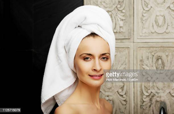 portrait of smiling woman in bathroom - wrapped in a towel stock pictures, royalty-free photos & images