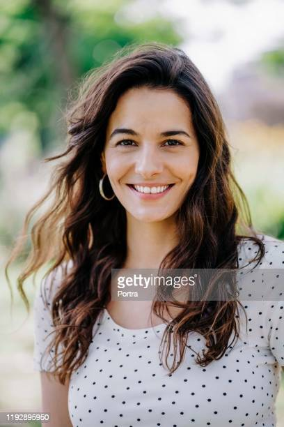 portrait of smiling woman in park - argentina stock pictures, royalty-free photos & images