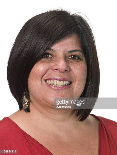 Portrait of smiling woman in red shirt on white background.
