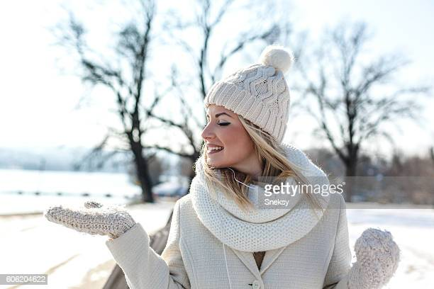 portrait of smiling woman in snow - mitten stock pictures, royalty-free photos & images