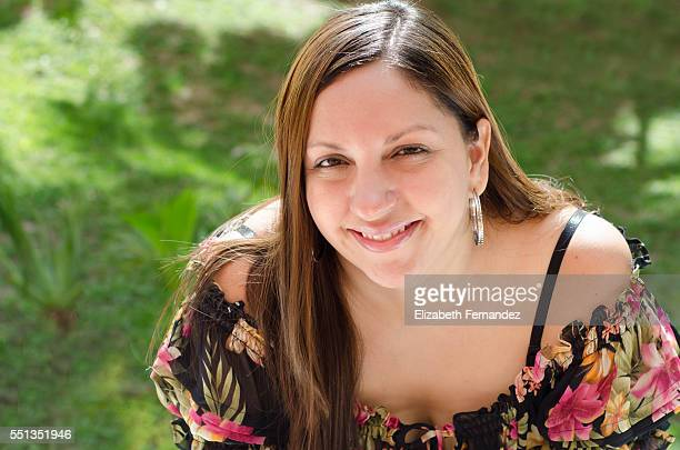 Portrait of smiling woman in sunny garden