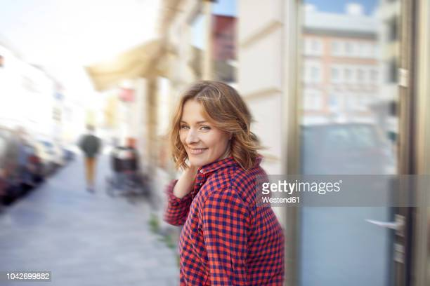 Portrait of smiling woman in the city