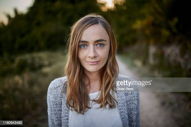 portrait of smiling woman in the countryside - one mid adult woman only stock pictures, royalty-free photos & images