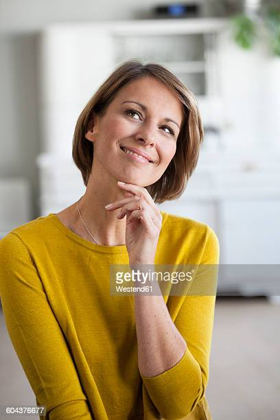 Portrait of smiling woman looking up