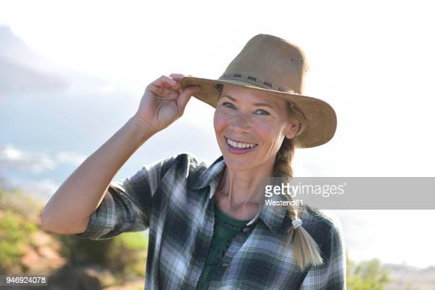 Portrait of smiling woman on a hiking trip