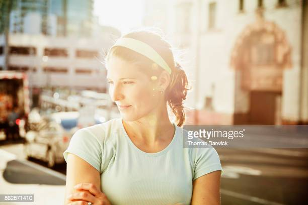 Portrait of smiling woman on city street before going on morning run