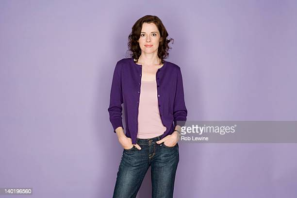 portrait of smiling woman on purple background, studio shot - colored background stock pictures, royalty-free photos & images