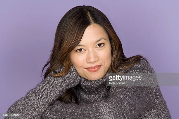 portrait of smiling woman on purple background, studio shot - purple background stock photos and pictures