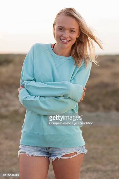 portrait of smiling woman outdoors - sweatshirt stock pictures, royalty-free photos & images