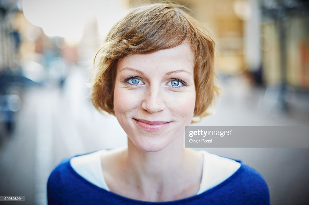 Portrait of smiling woman outdoors : Stock Photo