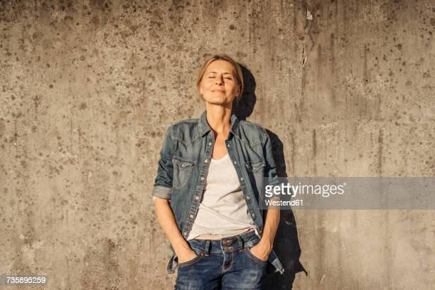 portrait of smiling woman outdoors - hands in pockets stock pictures, royalty-free photos & images