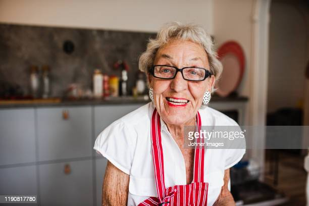 portrait of smiling woman - seniore vrouwen stockfoto's en -beelden