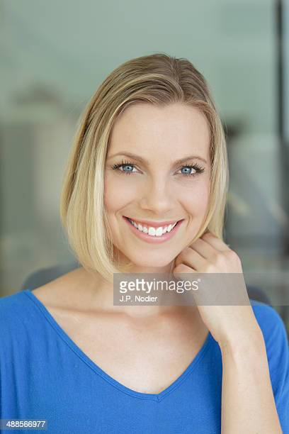 portrait of smiling woman - v neck stock pictures, royalty-free photos & images