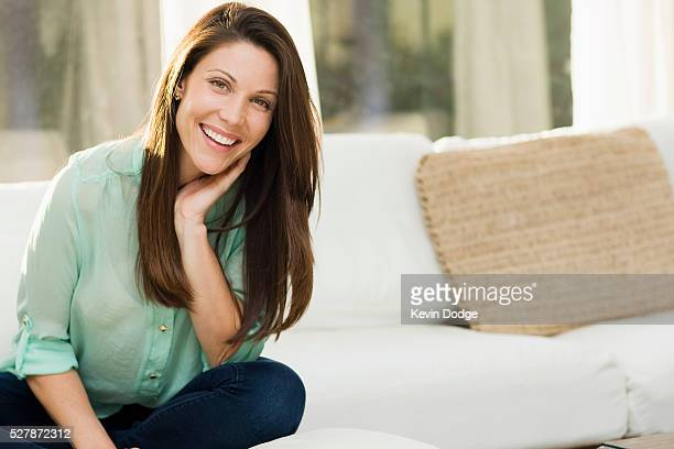 portrait of smiling woman - hand on chin stock pictures, royalty-free photos & images