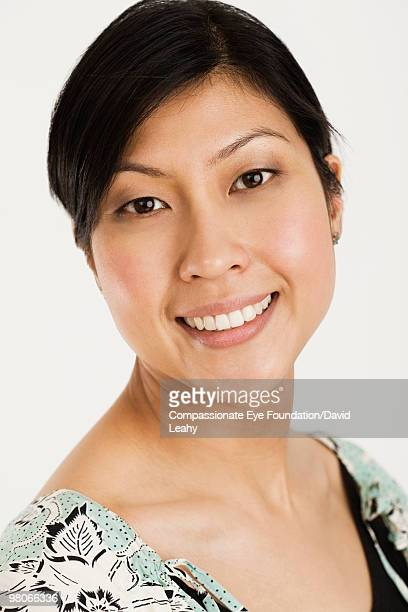 portrait of smiling woman - compassionate eye foundation stock pictures, royalty-free photos & images
