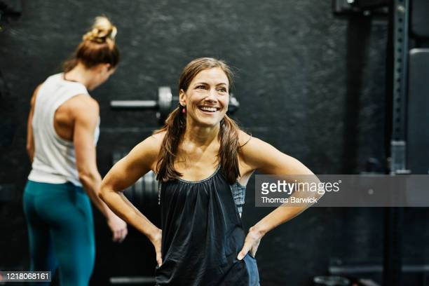 portrait of smiling woman resting during workout in gym - sleeveless stock pictures, royalty-free photos & images
