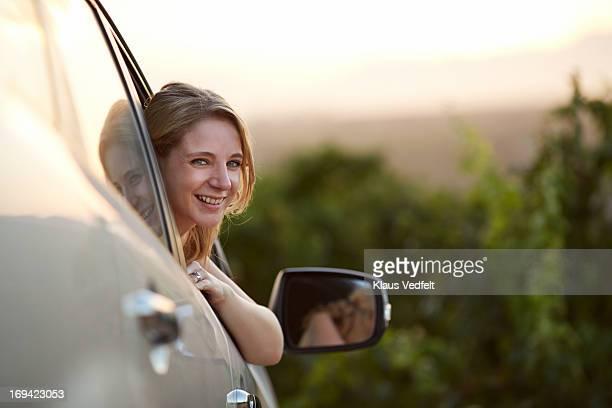 Portrait of smiling woman sitting i car