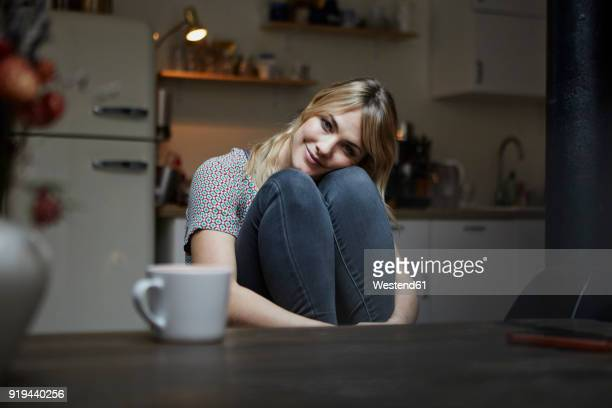 portrait of smiling woman sitting in the kitchen - admiration stock pictures, royalty-free photos & images