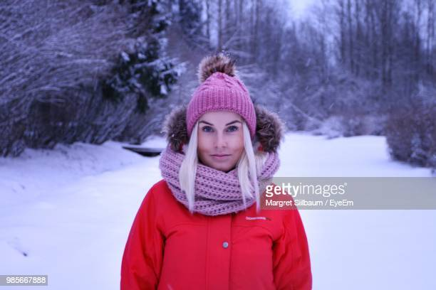 Portrait Of Smiling Woman Standing On Field During Winter